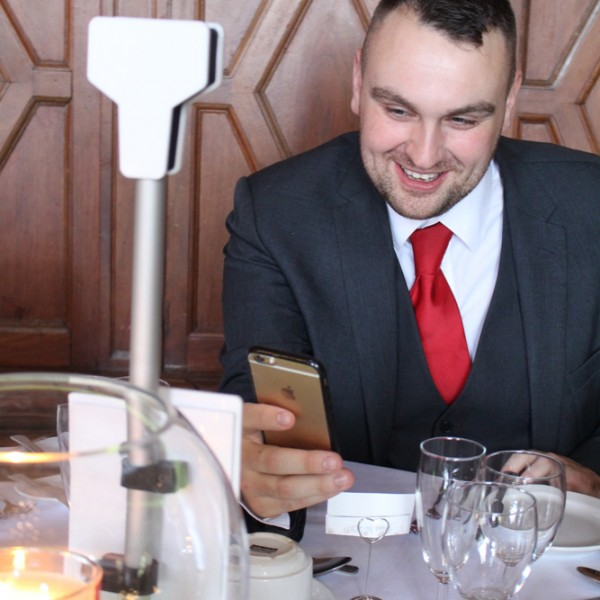 Man uses the new Table Selfie by Photobooths