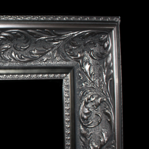 An ornate black and silver frame for Magic Mirrors